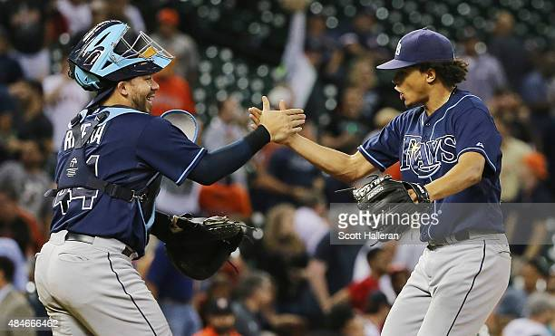 Chris Archer of the Tampa Bay Rays celebrates with his catcher Rene Rivera after his onehit complete game shutout as the Rays defeated the Houston...