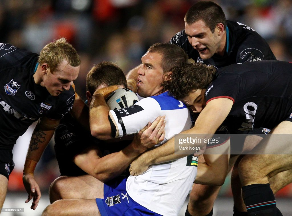 Chris Armit of the Bulldogs is tackled during the round 11 NRL match between the Penrith Panthers and the Canterbury Bulldogs at CUA Stadium on May 24, 2010 in Sydney, Australia.