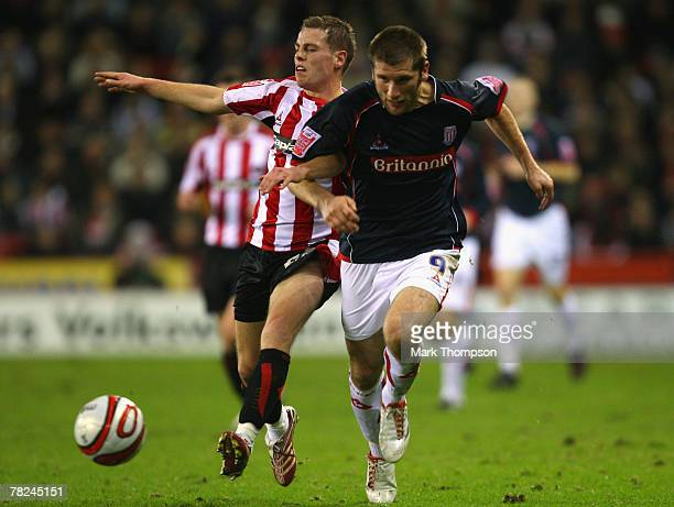 Chris Armstrong of Sheffield United tangles with Richard Cresswell of Stoke City during the CocaCola Championship match between Sheffield United and...
