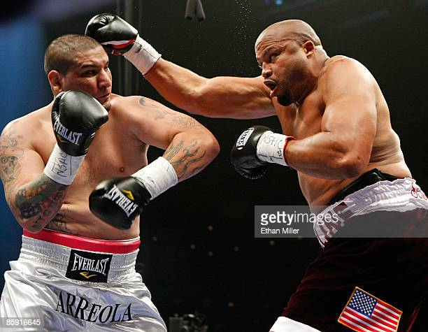 Chris Arreola and Jameel McCline trade blows in the first round of their heavyweight bout at the Mandalay Bay Events Center April 11 2009 in Las...