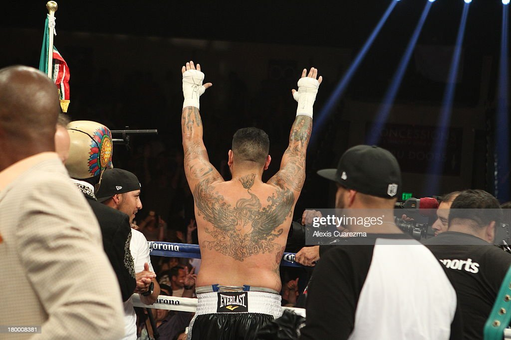 <a gi-track='captionPersonalityLinkClicked' href=/galleries/search?phrase=Chris+Arreola&family=editorial&specificpeople=3990515 ng-click='$event.stopPropagation()'>Chris Arreola</a> celebrates as his victorious over Seth Mitchell for the WBC International Heavyweight Title at the Fantasy Springs Resort Casino - Special Events Center on September 7, 2013 in Indio, California.