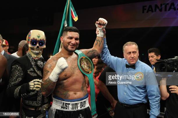 Chris Arreola celebrates his victory over Seth Mitchell as referee Jack Reiss holds his hand up for the WBC International Heavyweight Title at the...