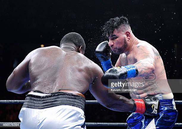 Chris Arreola defends against Curtis Harper during their 10 round heavyweight bout at Citizens Business Bank Arena March 13 2015 in Ontario California