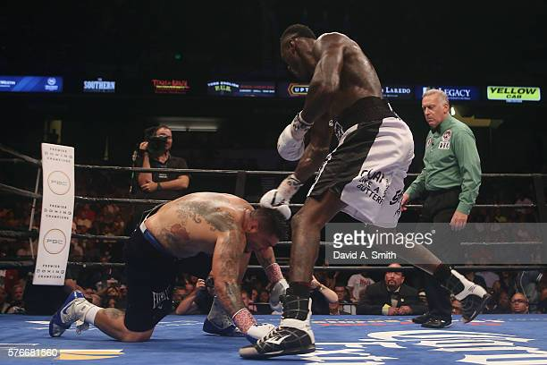 Chris Arreola is taken down by WBC World Heavyweight Champion Deontay Wilder during a title fight at Legacy Arena at the BJCC on July 16 2016 in...