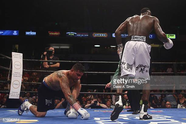 Chris Arreola is taken to the mat by WBC World Heavyweight Champion Deontay Wilder during a title fight at Legacy Arena at the BJCC on July 16 2016...