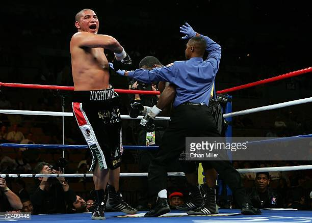 Chris Arreola jumps in the air as referee Kenny Bayless comes in to stop the fight in the 7th round against Damian Wills during their heavyweight...