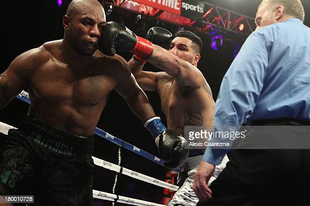 Chris Arreola lands a left against Seth Mitchell during their WBC International Heavyweight Title at the Fantasy Springs Resort Casino Special Events...