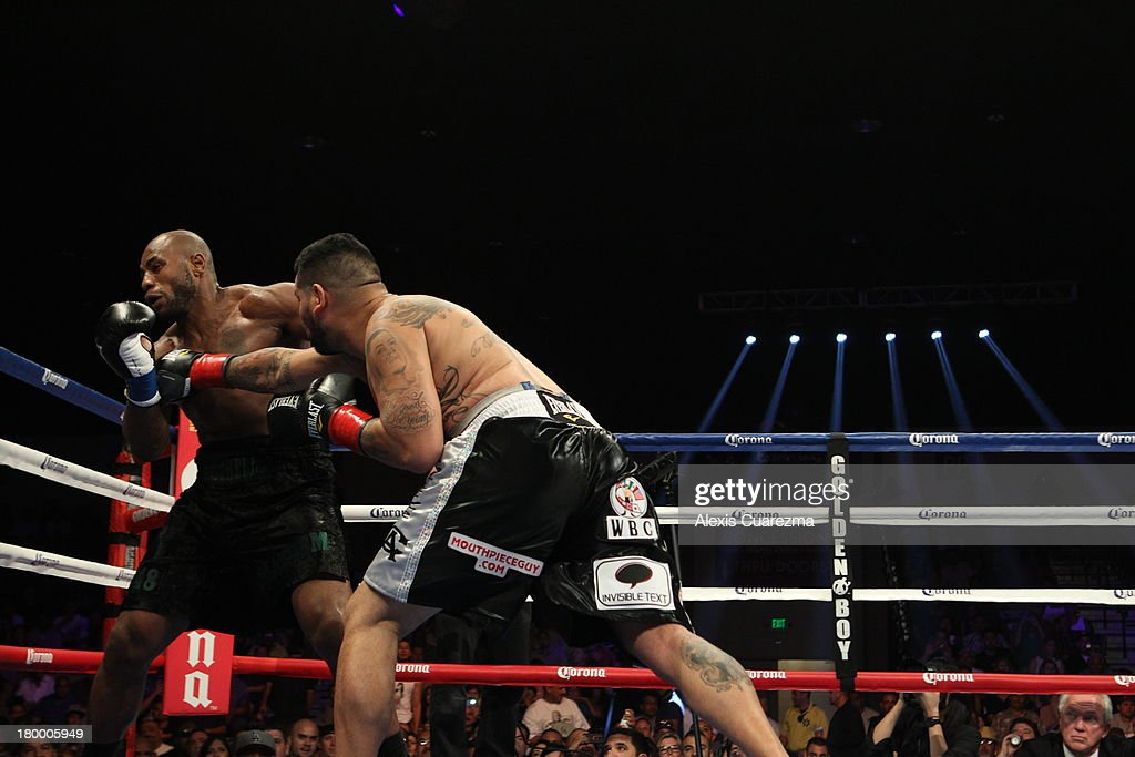 Chris Arreola (R) lands a right against Seth Mitchell (L) during their WBC International Heavyweight Title at the Fantasy Springs Resort Casino - Special Events Center on September 7, 2013 in Indio, California.
