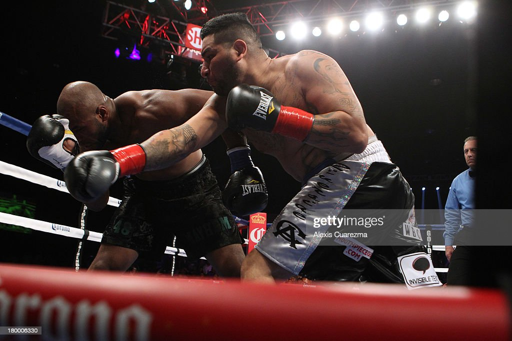 <a gi-track='captionPersonalityLinkClicked' href=/galleries/search?phrase=Chris+Arreola&family=editorial&specificpeople=3990515 ng-click='$event.stopPropagation()'>Chris Arreola</a> (R) lands a right against Seth Mitchell during their WBC International Heavyweight Title at the Fantasy Springs Resort Casino - Special Events Center on September 7, 2013 in Indio, California.