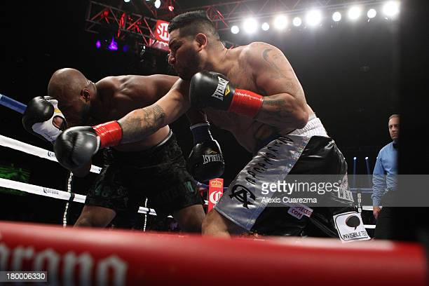 Chris Arreola lands a right against Seth Mitchell during their WBC International Heavyweight Title at the Fantasy Springs Resort Casino Special...