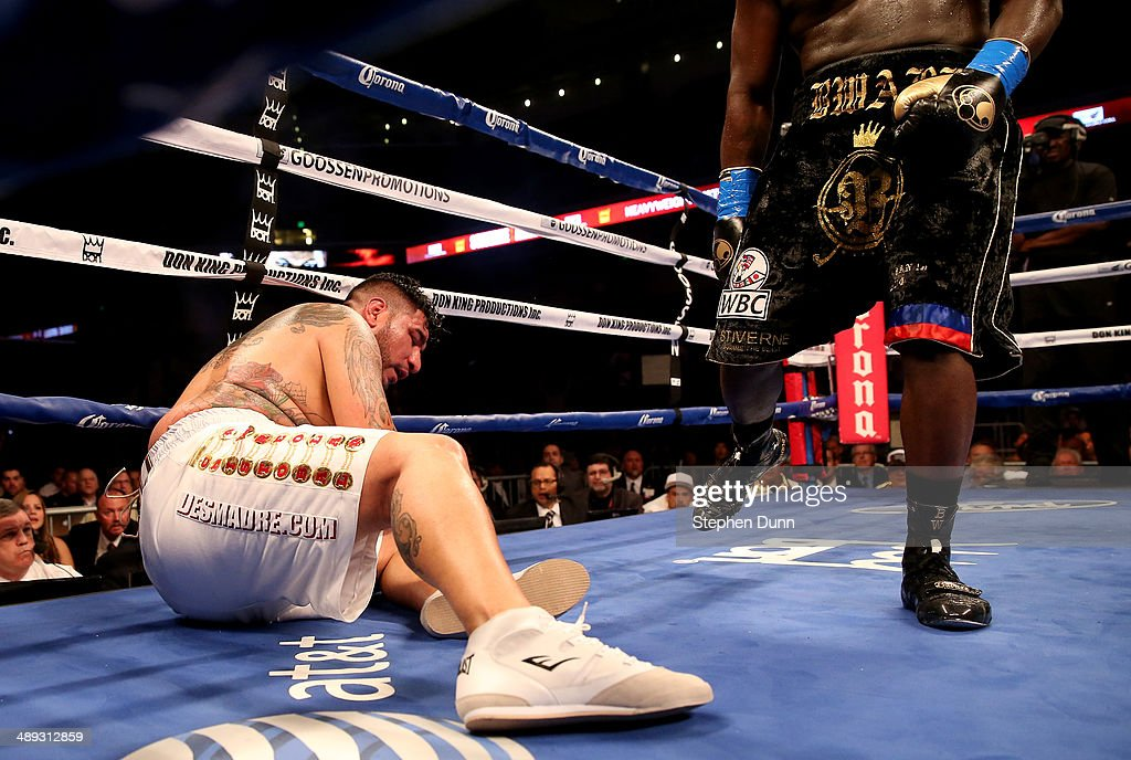Chris Arreola sits on the canvas after being knocked down for the first time in the sixth round by Bermane Stiverne in their WBC Heavyweight Championship match at Galen Center on May 10, 2014 in Los Angeles, California. Stiverne won in a six round technical knockout.