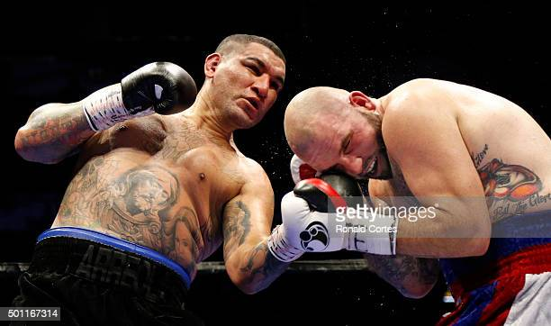 Chris Arreola throws a left at Travis Kauffman in their heavyweight bout at ATT Center on December 12 2015 in San AntonioTexas
