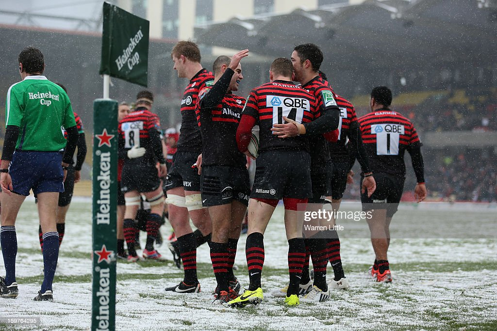 <a gi-track='captionPersonalityLinkClicked' href=/galleries/search?phrase=Chris+Ashton&family=editorial&specificpeople=2649431 ng-click='$event.stopPropagation()'>Chris Ashton</a> is congratulated after scoring a try during the Heineken Cup match between Saracens and Edinburgh Rugby at Vicarage Road on January 20, 2013 in Watford, England.
