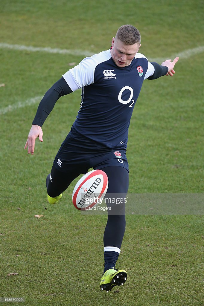 Chris Ashton kicks the ball upfield during the England training session at Pennyhill Park on March 14, 2013 in Bagshot, England.