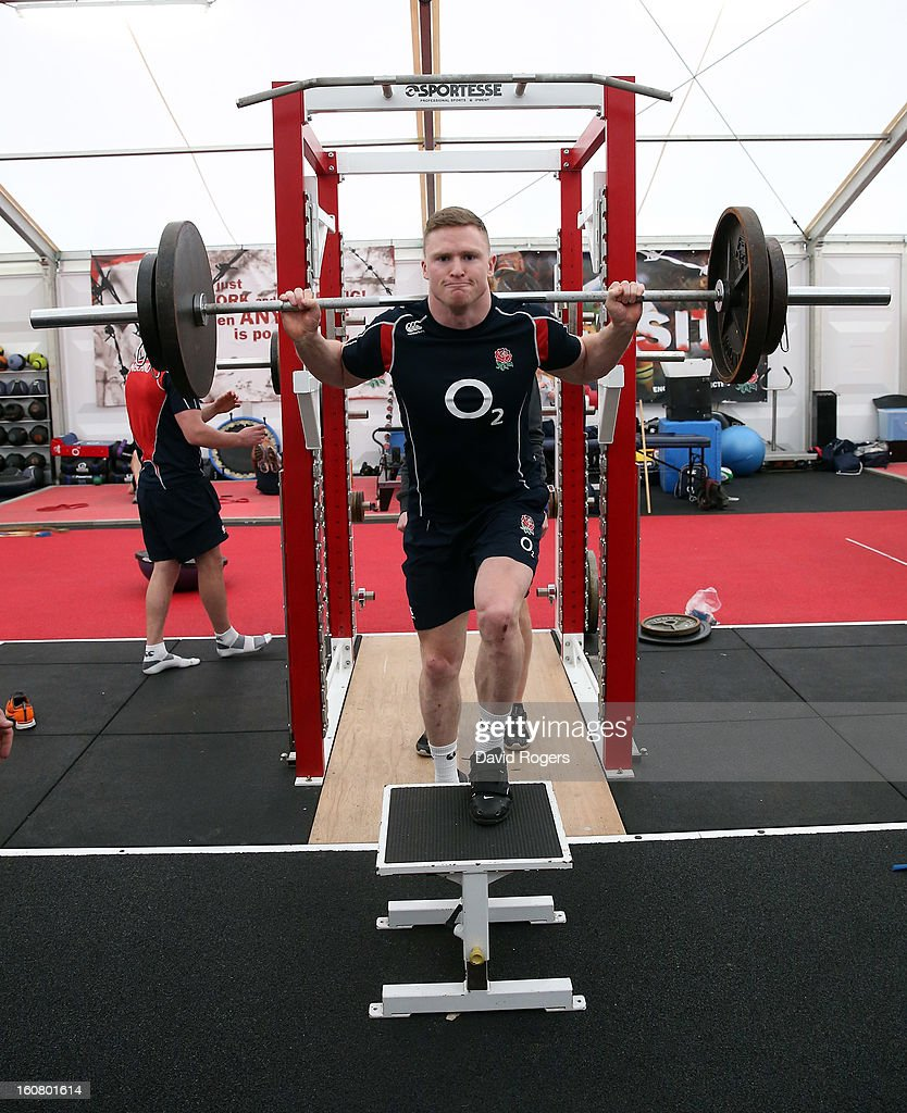 Chris Ashton lifts weights during the England gym session held at Pennyhill Park on February 6, 2013 in Bagshot, England.