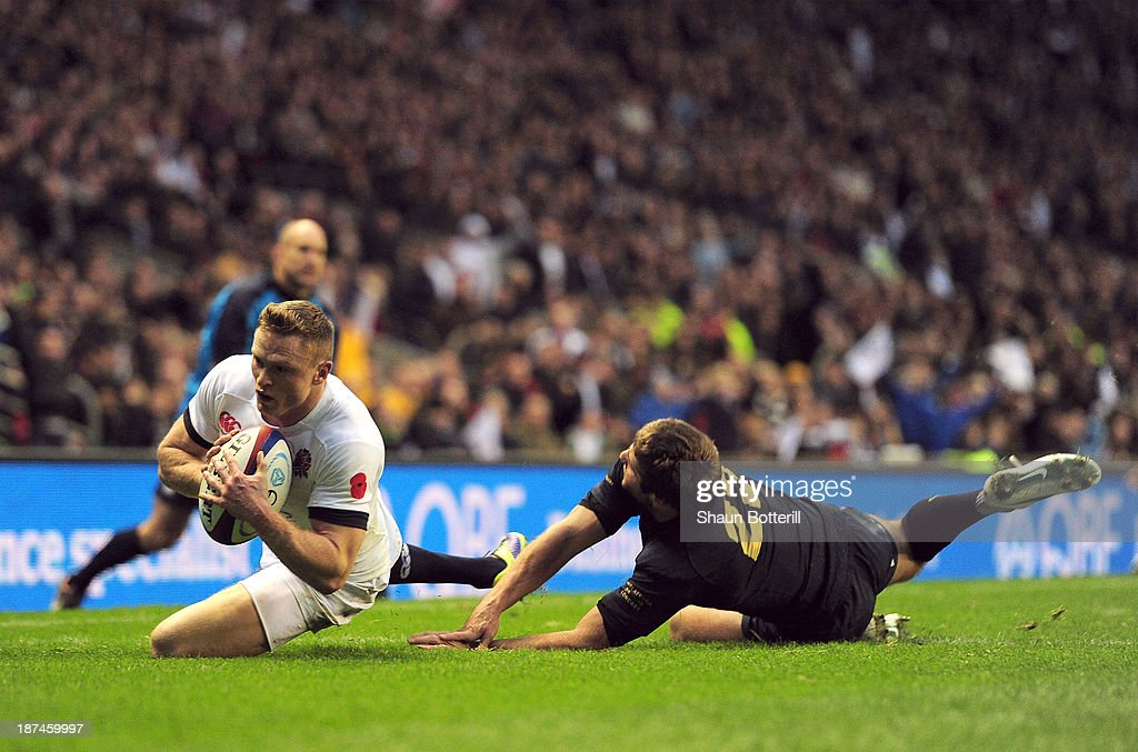 Chris Ashton of England beats the tackle of Santiago Cordero of Argentina to score a try during the QBE International match between England and Argentina at Twickenham Stadium on November 9, 2013 in London, England.