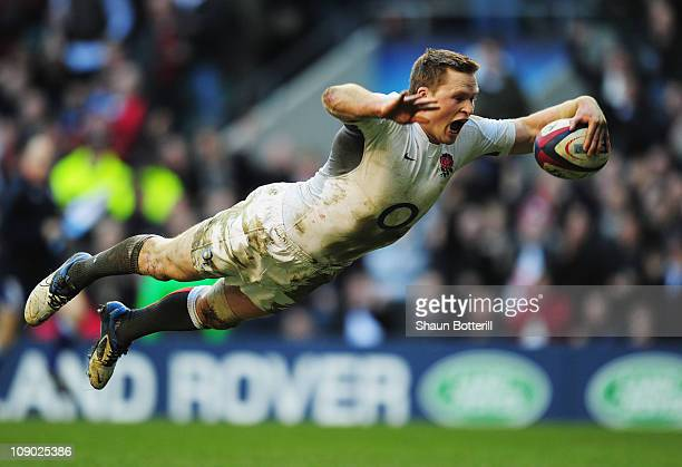 Chris Ashton of England dives over to score his team's eighth try try during the RBS 6 Nations Championship match between England and Italy at...