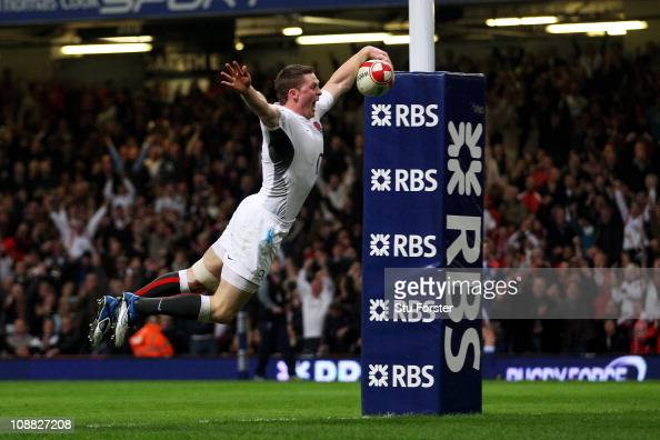 Chris Ashton of England dives over to score the opening try during the RBS 6 Nations Championship match between Wales and England at the Millennium...