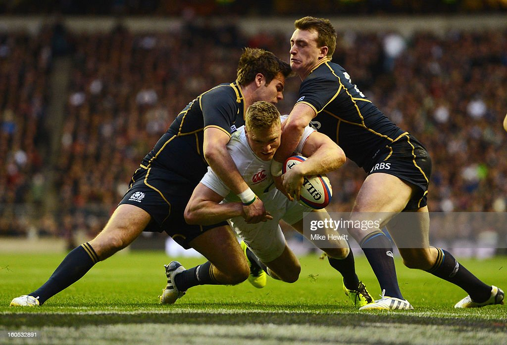 <a gi-track='captionPersonalityLinkClicked' href=/galleries/search?phrase=Chris+Ashton&family=editorial&specificpeople=2649431 ng-click='$event.stopPropagation()'>Chris Ashton</a> of England goes over to score his try during the RBS Six Nations match between England and Scotland at Twickenham Stadium on February 2, 2013 in London, England.