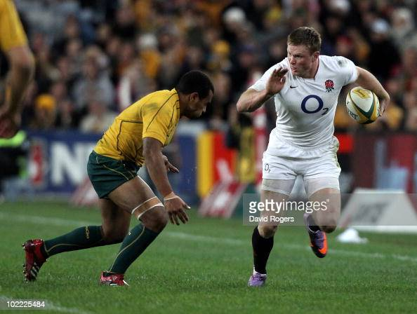 Chris Ashton of England moves past Will Genia during the Cook Cup Test Match between the Australian Wallabies and England at ANZ Stadium on June 19...