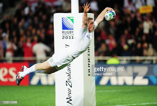 Chris Ashton of England scores their fifth try during the IRB 2011 Rugby World Cup Pool B match between England and Georgia at Otago Stadium on...