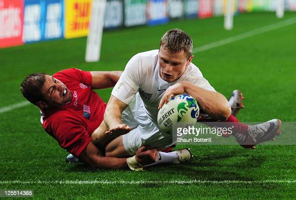 Chris Ashton of England scores their sixth try during the IRB 2011 Rugby World Cup Pool B match between England and Georgia at Otago Stadium on...