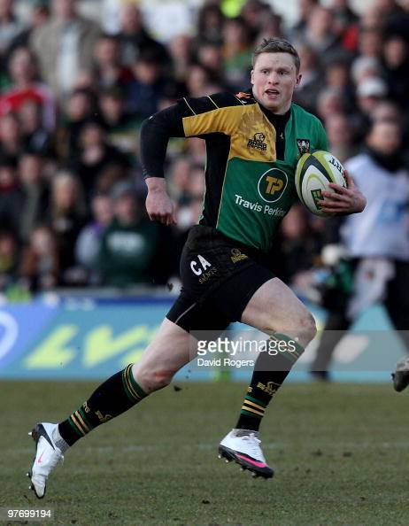 Chris Ashton of Northampton runs with the ball during the LV=Anglo Welsh Cup Semi Final between Northampton Saints and Saracens at Franklin's Gardens...
