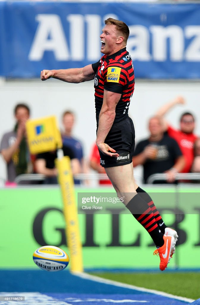 Chris Ashton of Saracens breaks away to score a try during the Aviva Premiership Semi Final match between Saracens and Harlequins at Allianz Park on May 17, 2014 in Barnet, England.