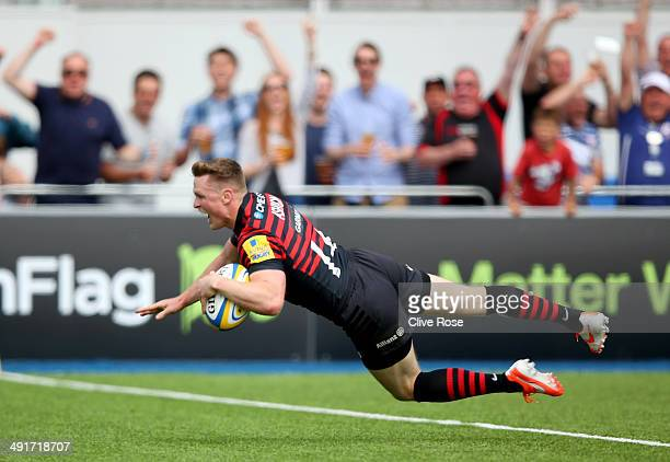 Chris Ashton of Saracens breaks away to score a try during the Aviva Premiership Semi Final match between Saracens and Harlequins at Allianz Park on...