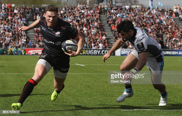Chris Ashton of Saracens breaks clear to score his second try during the European Rugby Champions Cup match between Saracens and Glasgow Warriors at...