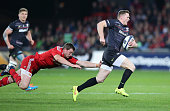 Chris Ashton of Saracens breaks with the ball during the European Rugby Champions Cup match between Munster and Saracens at Thomond Park on October...