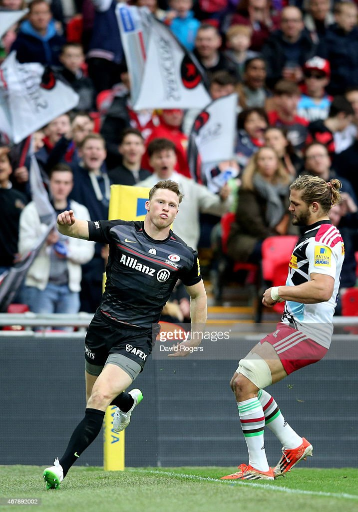 Chris Ashton of Saracens celebrates after scoring his team's third try during the Aviva Premiership match between Saracens and Harlequins at Wembley...