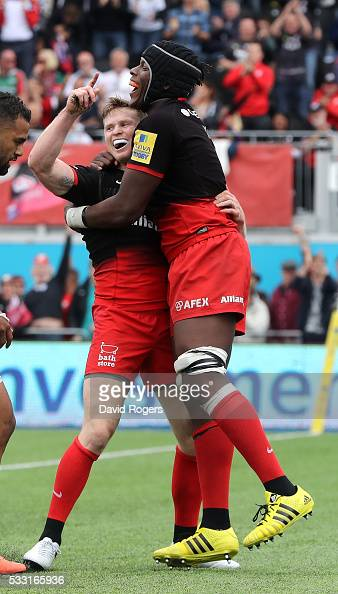 Chris Ashton of Saracens celebrates with team mate Maro Itoje after scoring a try during the Aviva Premiership semi final match between Saracens and...