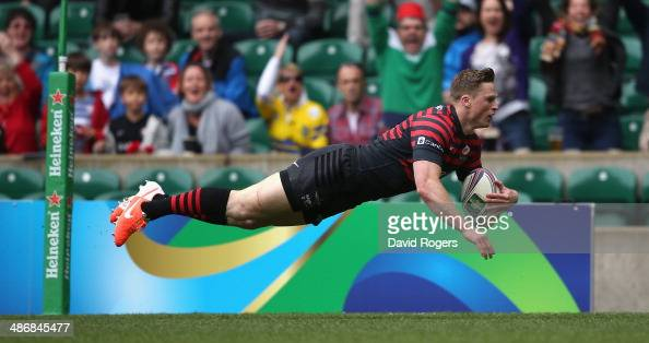Chris Ashton of Saracens dives over for the first try during the Heineken Cup semi final match between Saracens and Clermont Auvergne at Twickenham...