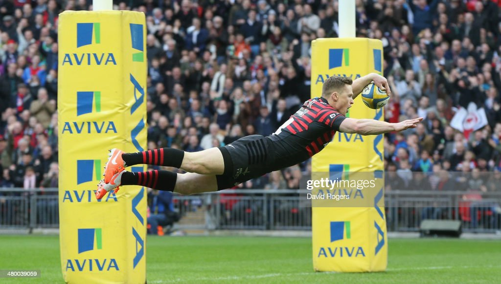 Chris Ashton of Saracens dives over for the first try during the Aviva Premiership match between Saracens and Harlequins at Wembley Stadium on March 22, 2014 in London, England.