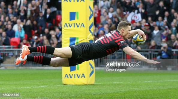 Chris Ashton of Saracens dives over for the first try during the Aviva Premiership match between Saracens and Harlequins at Wembley Stadium on March...