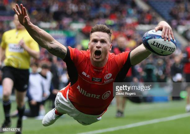 Chris Ashton of Saracens dives over for their first try during the European Rugby Champions Cup Final between ASM Clermont Auvergen and Saracens at...