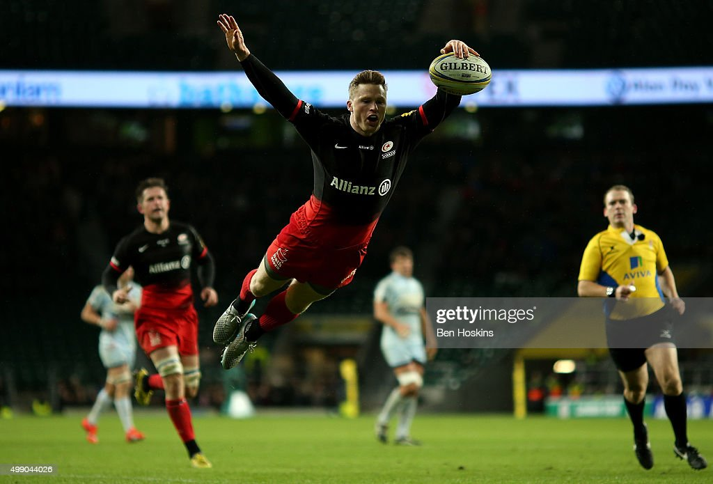 Chris Ashton of Saracens dives over to score a try during the Aviva Premiership match between Saracens and Worcester Warriors at Twickenham Stadium on November 28, 2015 in London, England.