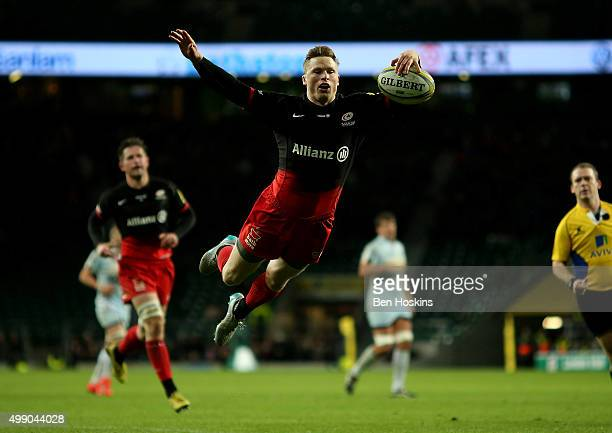 Chris Ashton of Saracens dives over to score a try during the Aviva Premiership match between Saracens and Worcester Warriors at Twickenham Stadium...
