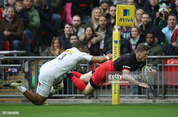 Chris Ashton of Saracens dives over to score a try during the Aviva Premiership between Saracens and Harlequins at Wembley Stadium on April 16 2016...