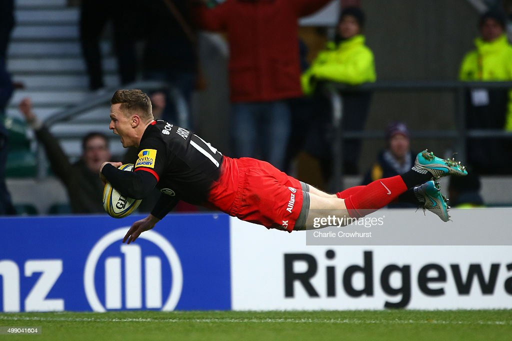 Chris Ashton of Saracens dives to score the first try of the game with team during the Aviva Premiership match between Saracens and Worcester Warriors at Twickenham Stadium on November 28, 2015 in London, England.