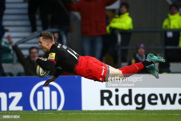 Chris Ashton of Saracens dives to score the first try of the game with team during the Aviva Premiership match between Saracens and Worcester...