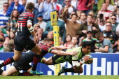 Chris Ashton of Saracens fails to stop George Pisi of Northampton Saints goes over to score their second try during the Aviva Premiership Final...