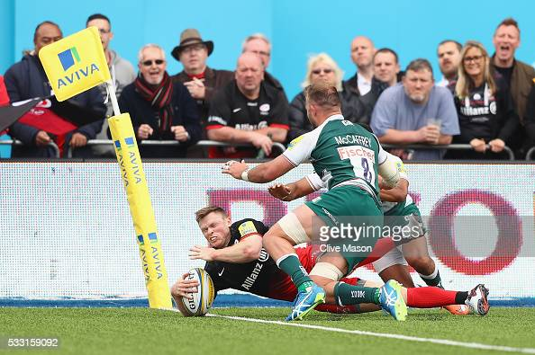 Chris Ashton of Saracens goes over the line to score a try during the Aviva Premiership semi final match between Saracens and Leicester Tigers at...