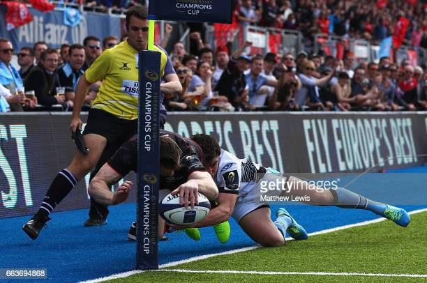 Chris Ashton of Saracens is tackled by Lee Jones of Glasgow Warriors to deny Saracens a try during the European Rugby Champions Cup match between...