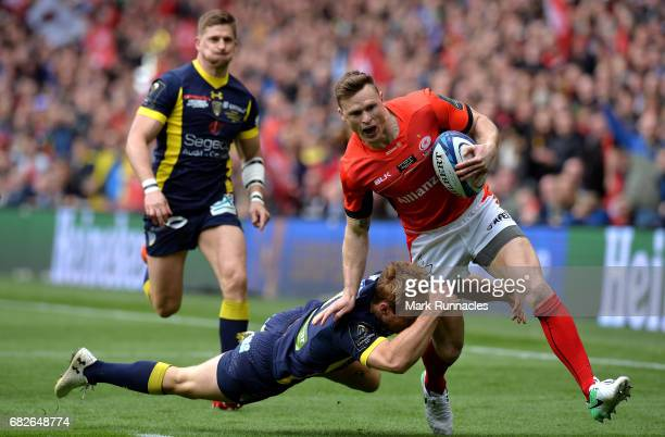 Chris Ashton of Saracens is tackled by Nick Abendanon of Clermont Auvergne during the European Rugby Champions Cup Final between ASM Clermont...