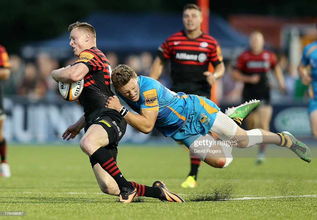 <a gi-track='captionPersonalityLinkClicked' href=/galleries/search?phrase=Chris+Ashton&family=editorial&specificpeople=2649431 ng-click='$event.stopPropagation()'>Chris Ashton</a> of Saracens is tackled by Tom Howe of London Wasps during the J.P. Morgan Asset Management Premiership 7's at Allianz Park on August 3, 2013 in Barnet, England.