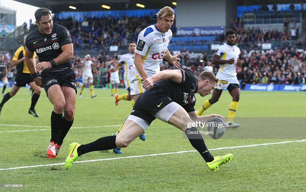 Chris Ashton of Saracens scores his second try of the match during the European Rugby Champions Cup match between Saracens and ASM Clermont Auvergne at Allianz Park on October 18, 2014 in Barnet, England.