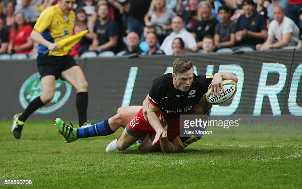Chris Ashton of Saracens scores their second try during the Aviva Premiership match between Worcester Warriors and Saracens at Sixways Stadium on May...