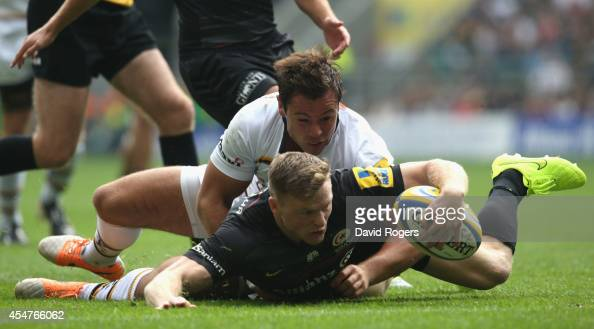 Chris Ashton of Saracens scrambles over to score the first try during the Aviva Premiership match between Saracens and Wasps at Twickenham Stadium on...